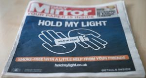 The front of a four-page wraparound advertisement by Philip Morris calling on people to quit smoking for 30 days on the front page of the 'Daily Mirror' in London. Photograph: Andrew Winning/Reuters