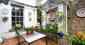Patio garden in basement flat in 41 Upper Leeson Street: house and mews is for sale for €1.35 million