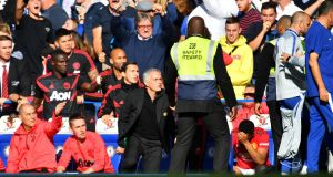 Manchester United manager José Mourinho reacts to Chelsea assistant coach Marco Ianni after Chelsea's second goal. Photo: Dylan Martinez/Reuters