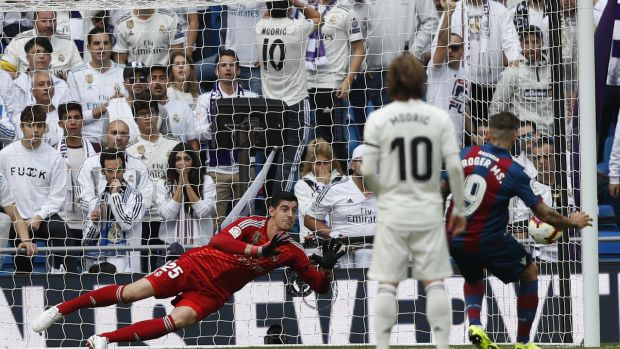 Roger Marti scores a penalty to put Levante 2-0 up. Photo: Javier Lizon/EPA