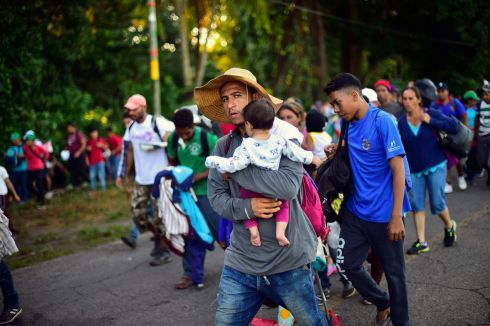 EXODUS: A caravan of Honduran migrants moves in the direction of the US border, on their way to Tapachula, Chiapas state, Mexico. US president Donald Trump has called the migrant caravan a national emergency, saying he has alerted the US border patrol and military. Photograph: Pedro Pardo/AFP/Getty Images