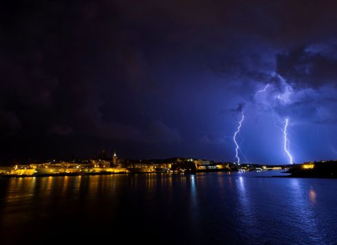 BOLT FROM THE BLUE: Lightning flashes during a storm over Valletta, Malta. Photograph: Darrin Zammit Lupi/Reuters
