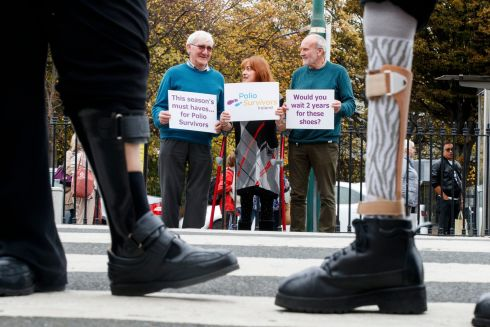 STAND UP FOR SURVIVORS: Robert Alcorn, Bridget Quigley O'Brien and  James Kavanagh, members of Polio Survivors Ireland, join a protest over waiting lists for customised shoes. Getting the shoes can take up to two years, while the alternative is to pay €600-€1,200 for the essential footwear. World Polio Day falls on Wednesday. Photograph: Andres Poveda