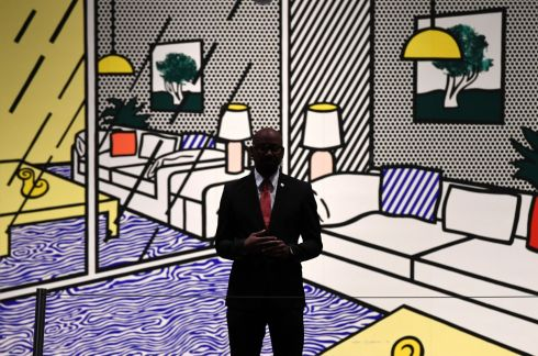 FOR SALE: An auction official stands guard in front of Roy Lichtenstein's Wallpaper with Blue Floor Interior (1992) at Christies auction house, New York. The work will be included in the Prints & Multiples auction this week. Photograph: Timothy A Clary/AFP/Getty Images