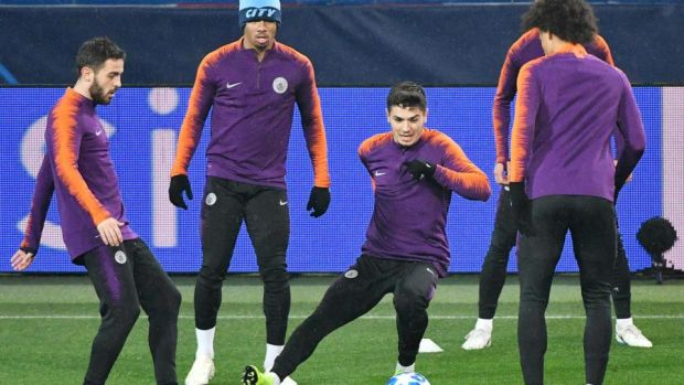 Manchester City's players take part in a training session at the Metallist stadium in Kharkiv on eve of their Uefa Champions League match against Shakhtar Donetsk. Photograph: Genya Savilov/AFP/Getty Images