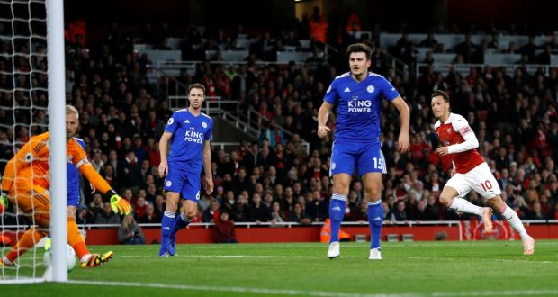 ad768bf8e Arsenal s Mesut Ozil scores their first goal of the Premier League win over  Leicester City at