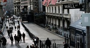 Wall Street sank on Tuesday, continuing a punishing month for US stocks, as dismal outlook from industrial bellwethers Caterpillar and 3M sparked concerns over corporate growth