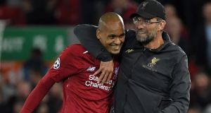 Brazilian midfielder Fabinho and manager Jürgen Klopp after the final whistle of the match against Paris Saint-Germain. Photograph: Paul Ellis/AFP/Getty Images