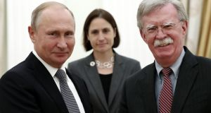 Vladimir Putin with John Bolton:  talks came after the US president threatened to pull out of a nuclear arms treaty with Russia. Photograph: Maxim Shipenkov/AFP/Getty Images