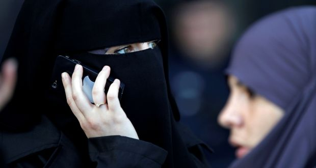File image of a woman in a niqab receiving a phone call  in Meaux, east of Paris, France. File photograph: Charles Platiau/Reuters
