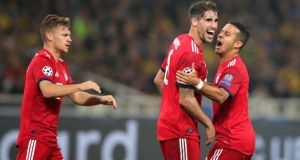 Bayern Munich's  Javier Martinez  (centre) celebrates with team-mates after scoring his team's first goal in the Champions League game against AEK Athens  at the Olympic Stadium  in Athens. Photograph: Alexander Hassenstein/Bongarts/Getty Images
