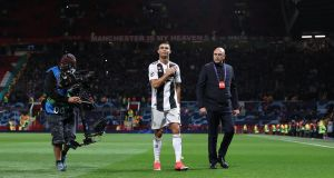 Cristiano Ronaldo leaves the Old Trafford pitch after Juve's 1-0 win over Manchester United. Photograph: Martin Rickett/PA