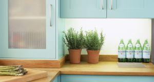 Turquoise painted kitchen units and cupboards.