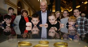 Sam Bates and Alisha Wauchope, grand children of Norman Witherow (centre),  one of the finders of the Tullydonnell hoard unearthed near Convoy in Co Donegal. Photograph: Alan Betson / The Irish Times