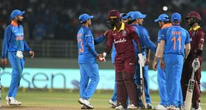 Indian cricket captain Virat Kohli (left) and team-mates shake hands with the West Indies batsmen after the second one-day international ended in a tie in Visakhapatnam. Photograph: Noah Seelam/AFP/Getty Images