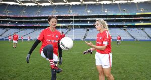 Sonia O'Sullivan and Anna Geary warm up before the Croke Park Charity Challenge between Cork and Mayo   in support of Self Help Africa and Alan Kerins. Photograph: Damien Eagers