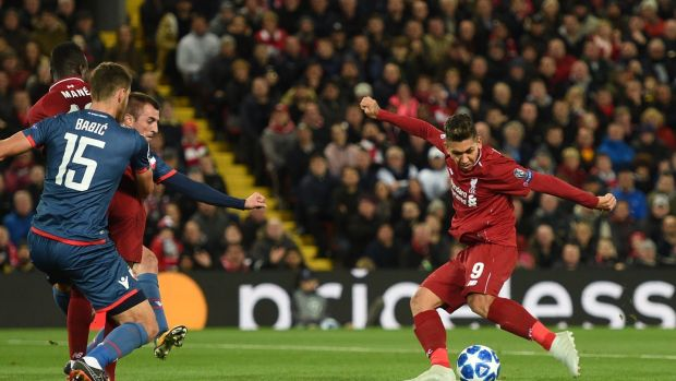 Liverpool's Roberto Firmino opens the scoring in the Champions League Group C match against Red Star Belgrade at Anfield. Photograph: Oli Scarff/AFP/Getty Images