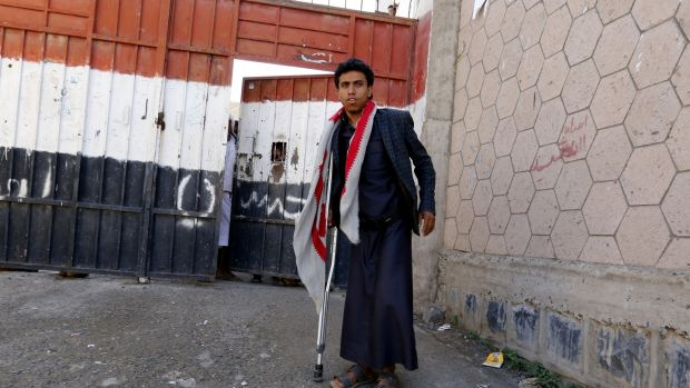 A conflict-wounded Yemeni student leaves his school to have a breakfast during a break in Sana'a, Yemen. Photograph: Yahya Arhab/EPA