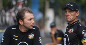 Johan Bruyneel (L) with Lance Armstrong after the 20th stage of the 2010 Tour de France. Photograph: Bryn Lennon/Getty