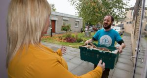 Darragh Doyle of Foodcloud delivering items to Paula Mahon of Jobstown Against Drug Dependency. Photograph: Dave Meehan