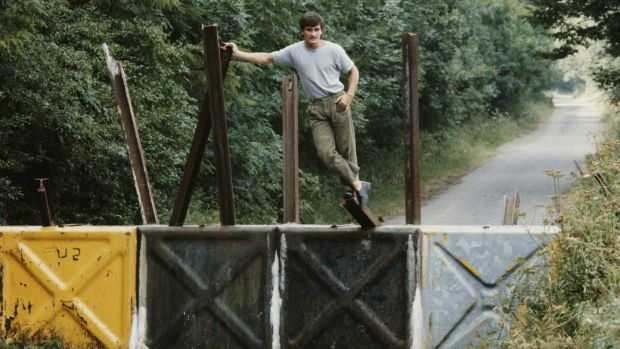 Former world champion boxer Barry McGuigan, from Clones, posing astride the Border between the Republic of Ireland and Northern Ireland in 1984. Photograph: Michael Brennan/Getty Images