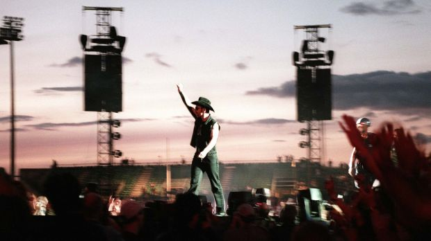 The Edge arrives onstage at Lansdowne Road during U2's PopMart tour in August 1997. Photograph: Terry Thorp