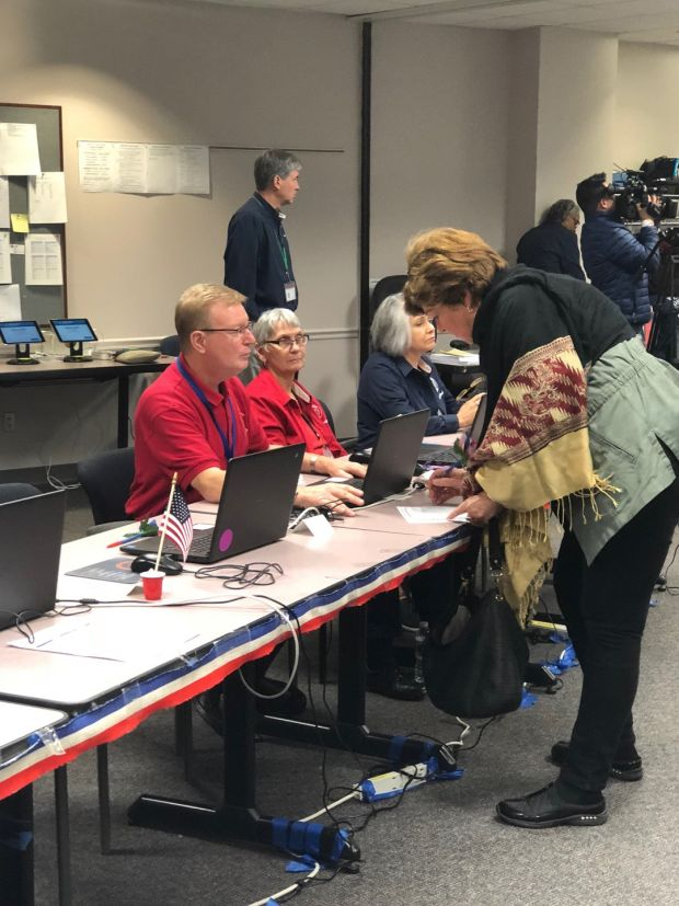 Early voters in the US midterm elections cast their ballots in Fairfax County, Virginia. Photograph: Suzanne Lynch