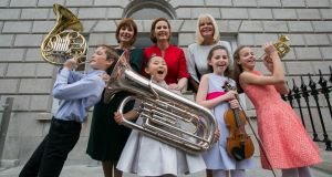 Minister for Culture Josepha Madigan, RIAM director Deborah Kelleher, Minister of State for Higher Education Mary Mitchell O'Connor and (front row) Cormac Mac Canna (10), Yikai Zhao (7), Sarah Brazil (10) and Charlotte Croke (11) during Thursday's announcement. Photograph: Gareth Chaney Collins