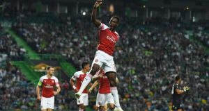 Arsenal's Danny Welbeck celebrates scoring his side's goal during the Europa League Group E match against Sporting Lisbon at the Estádio José Alvalade in Lisbon. Photograph: David Ramos/Getty Images