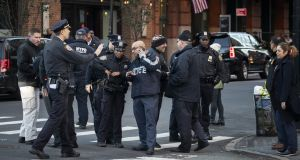 Law enforcement officials gather near the scene of where a suspected  bomb was found early on Thursday morning at Robert De Niro's TriBeCa Grill restaurant in New York. Photograph: Drew Angerer/Getty Images