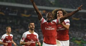 Danny Welbeck celebrates his winner for Arsenal in Lisbon. Photograph: Francisco Leong/AFP/Getty