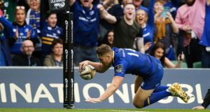 Jordan Larmour crosses for Leinster during the Pro14 final against the Scarlets. Photograph: Tommy Dickson/Inpho