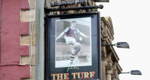 The Turf pub sign in Burnley  depicts an image of ex-player, Northern Ireland's James McIlroy, who was instrumental to the club's league title success in 1960. Photograph:  Ian MacNicol/Getty Images