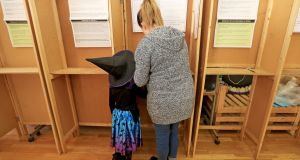LJ McAlevay casts her vote at St Laurence O'Toole CBS in Sherrif Stree with her daughter Maisie (5). Photograph: Donall Farmer/The Irish Times