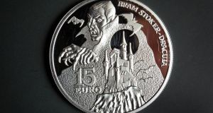 The limited-edition coin designed by David Rooney.