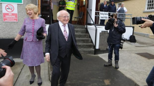President Michael D Higgins and his wife, Sabina, leave St Mary's hospital in Phoenix Park after casting their votes in the presidential election and the blasphemy referendum. Photograph: Collins