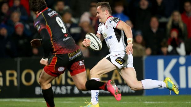 Ulster's Michael Lowry breaks free and runs in a try during the Guinness Pro 14 game against Dragons at Kingspan stadium. Photograph: Tommy Dickson/Inpho