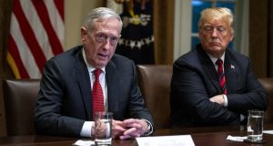 Jim Mattis, US secretary of defence, speaks next to Donald Trump during a briefing with senior military leaders in the Cabinet Room of the White House in Washington on Tuesday. Photograph: Al Drago/Bloomberg