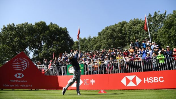 McIlroy tees off on the 10th during the third round. Photo: Ross Kinnaird/Getty Images