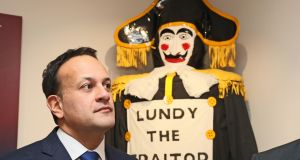 Taoiseach Leo Varadkar  during a visit to the association's Memorial Hall in Londonderry. Behind is an effigy of 'Lundy', regarded as a traitor by loyalists during the Siege of Derry in 1689. Photograph: Brian Lawless/PA Wire