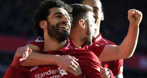 Liverpool's Egyptian attacker Mohamed Salah celebrates scoring against Cardiff City at Anfield. Photograph: Getty Images