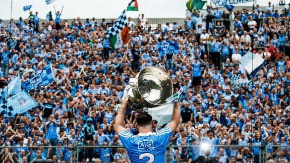 Dublin's Philly McMahon lifts the Sam Maguire in front of Hill 16. Photograph: Tommy Dickson/Inpho