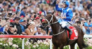 Hugh Bowman celebrates after Winx's record victory in Melbourne. Photograph: Michael Dodge/Getty