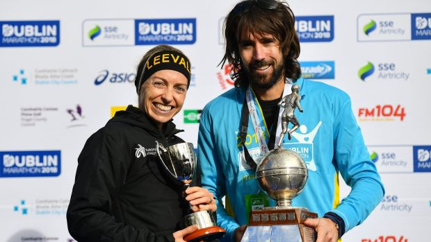Lizzie Lee and Mick Clohisey after finishing third and sixth respectively in the Dublin Marathon. Photograph: Ramsey Cardy/Sportsfile