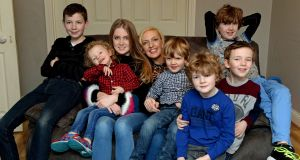 Jen Hogan with her daughter Chloe and sons, from left, Adam, Noah, Zach, Tobey, Luke and Jamie, in their home in Co Dublin. Photograph: Cyril Byrne / THE IRISH TIMES