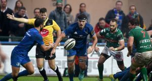 Leinster's Max Deegan passes to Jamison Gibson-Park in their Pro14 clash against Benetton at  Stadio Monigo in Treviso. Photograph: Elena Barbini