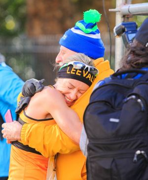 Winner of the  women's Irish National Marathon title Lizzie Lee hugs Lee Vale running club coach Donal Walsh. Photograph: Gareth Chaney/Collins