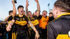 Dr Crokes' Tony Brosnan and Michael Burns celebrate after the match. Photograph: James Crombie/Inpho