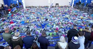 Supporters pay tribute at Leicester City following a helicopter crash. Photograph: Aaron Chown/PA Wire