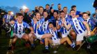 Ballyboden celebrate with the trophy after beating Kilmacud Crokes. Photograph: Oisin Keniry/Inpho